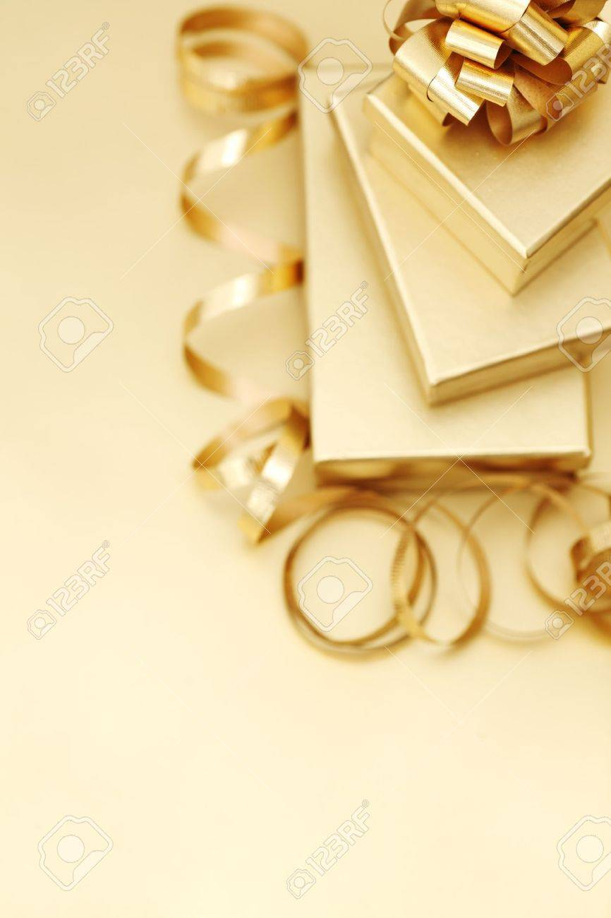 golden christmas gifts on gold background Stock Photo - 10254841