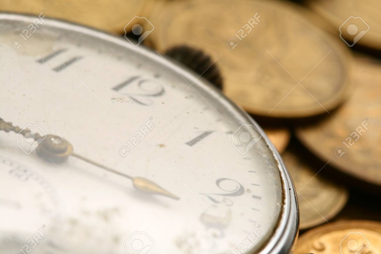 time is money coins and clock macro concet Stock Photo - 10264504
