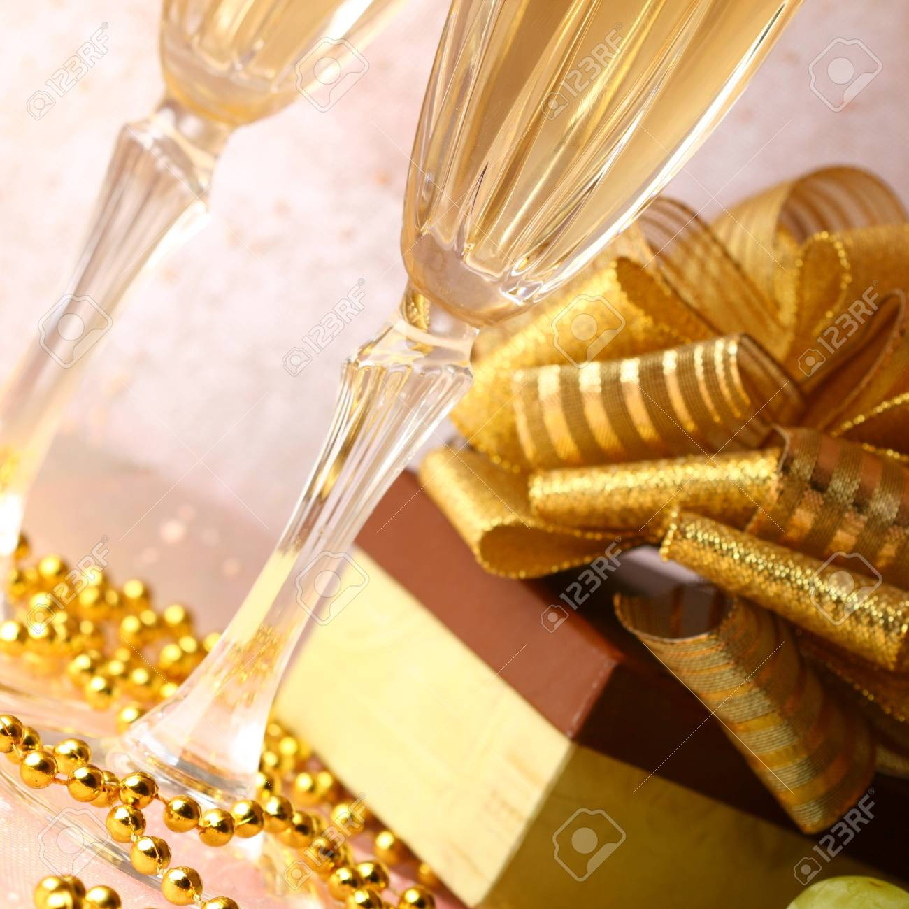holiday card golden champagne and gift Stock Photo - 10316123