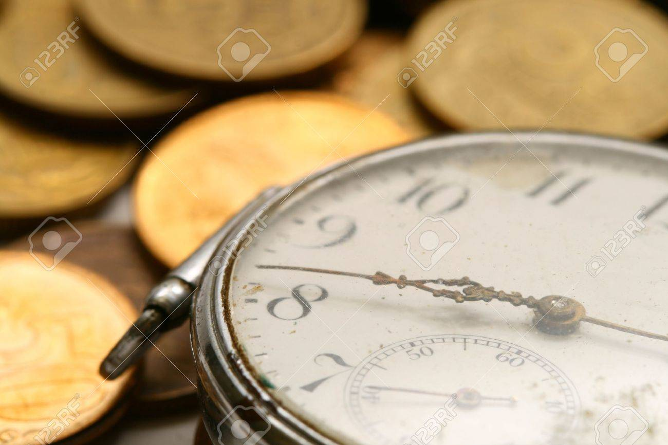 time is money coins and clock macro concet Stock Photo - 10316125