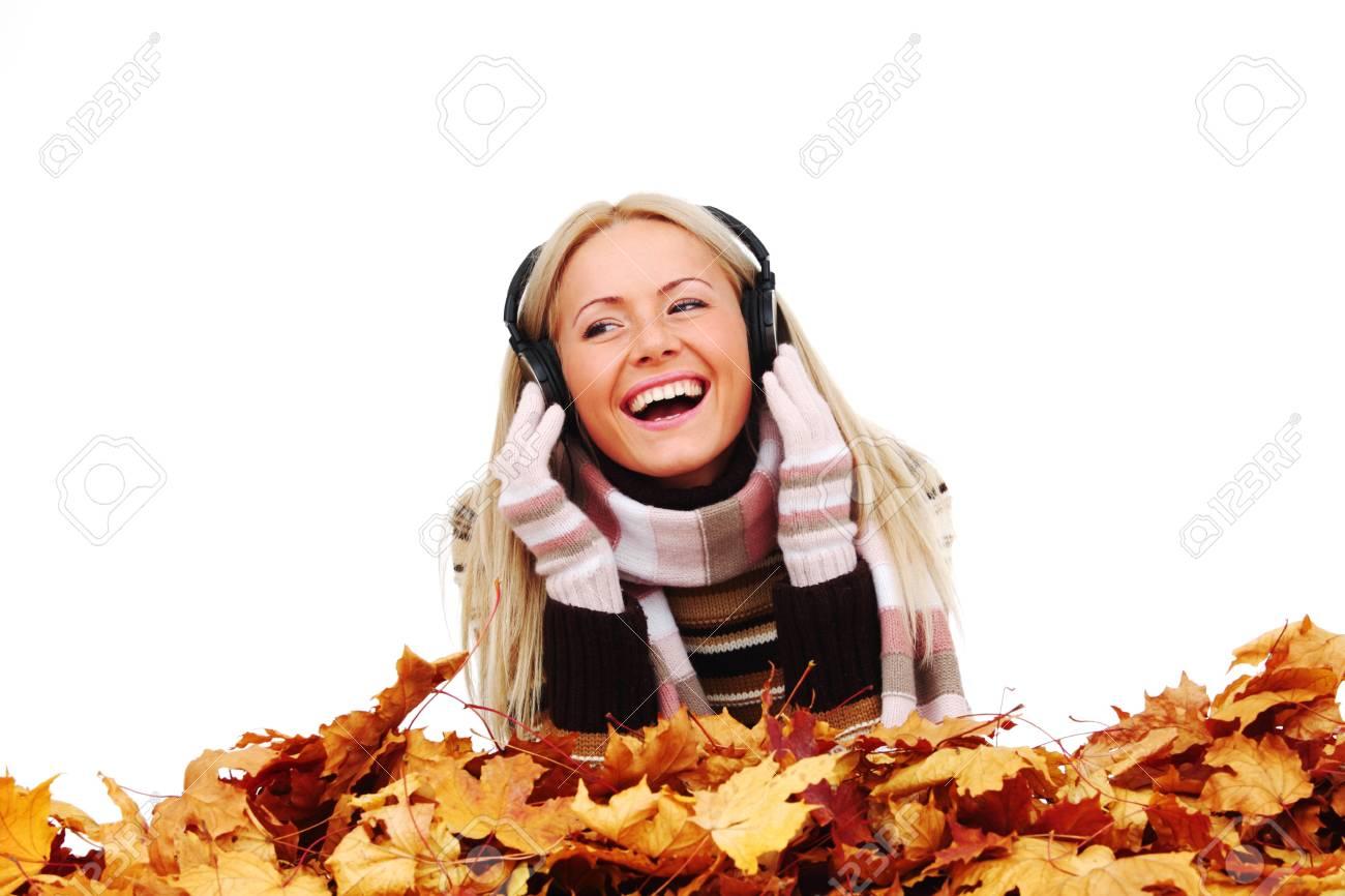 autumn woman listening music in studio Stock Photo - 10435552