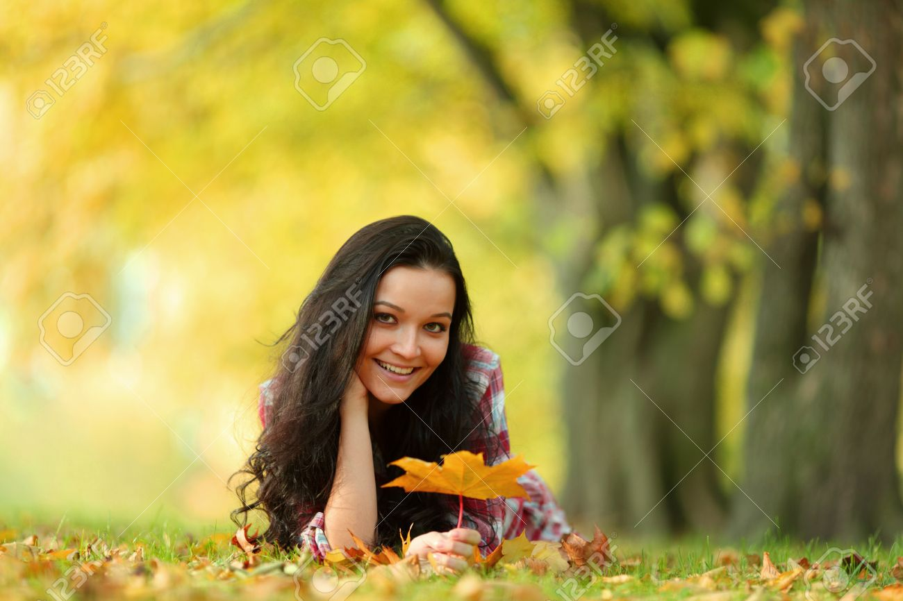 woman portret in autumn leaf close up Stock Photo - 10469819