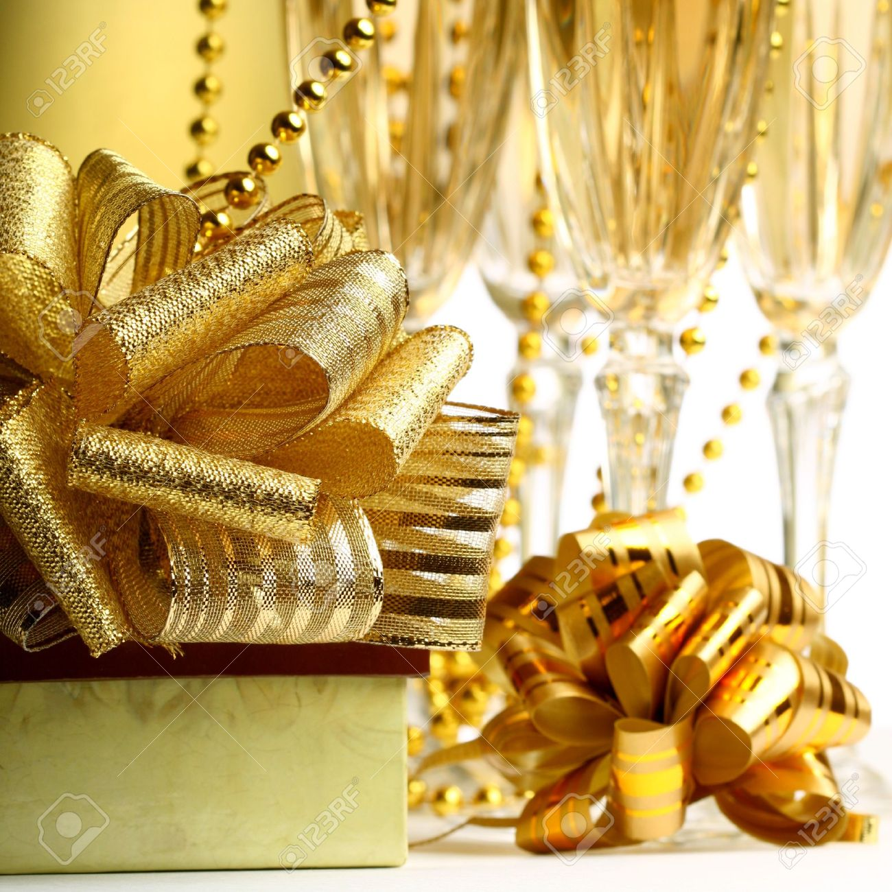 holiday card golden champagne and gift Stock Photo - 10535102