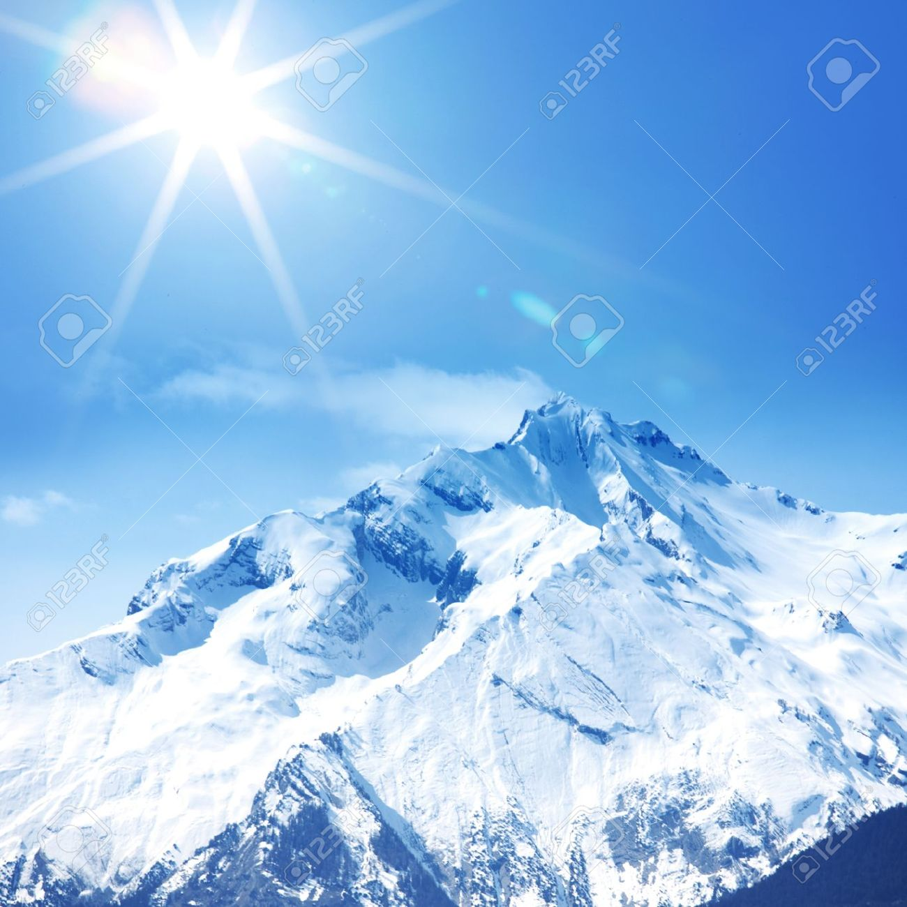 top of mountains sun in blue sky - 10535561