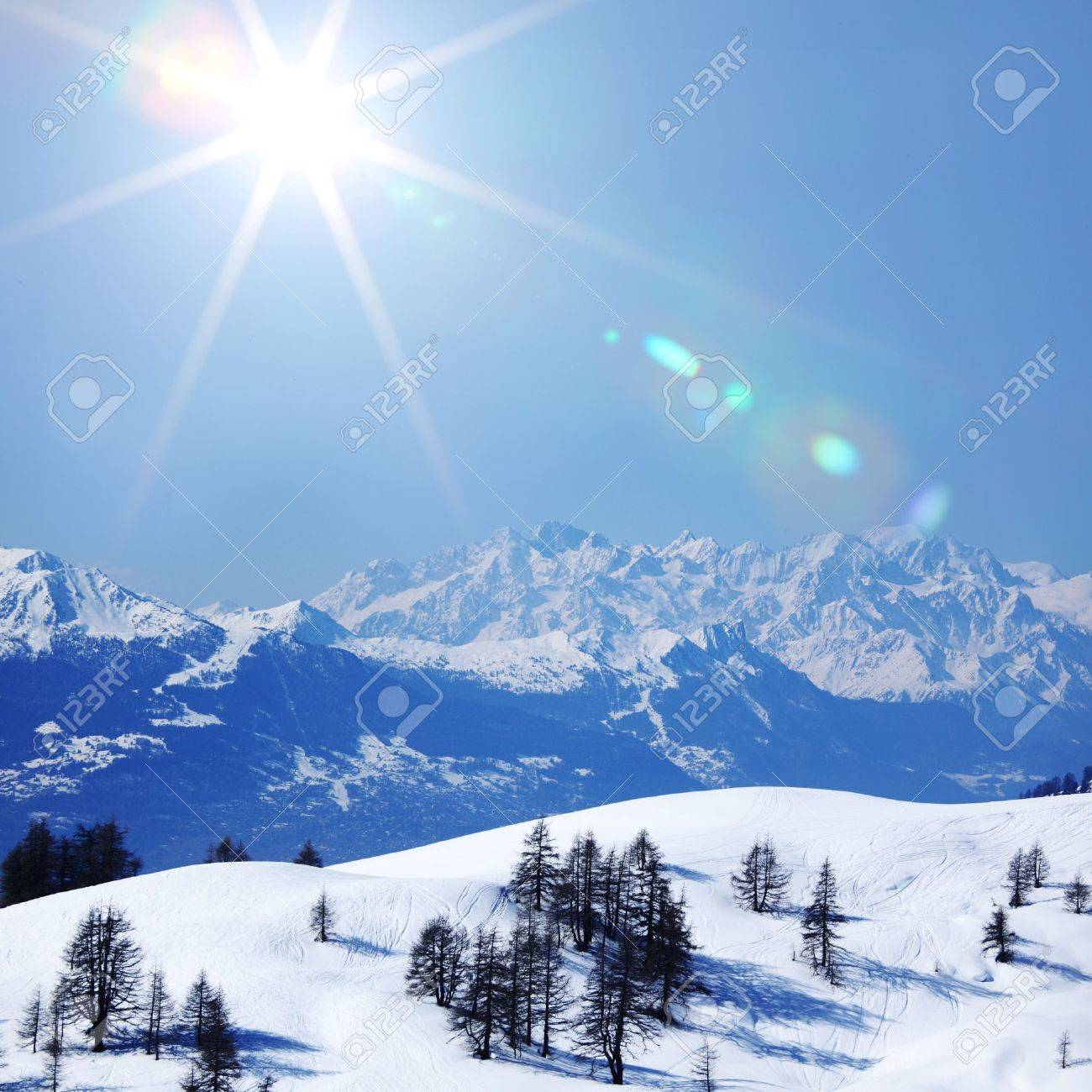 top of mountains sun in blue sky Stock Photo - 10535159