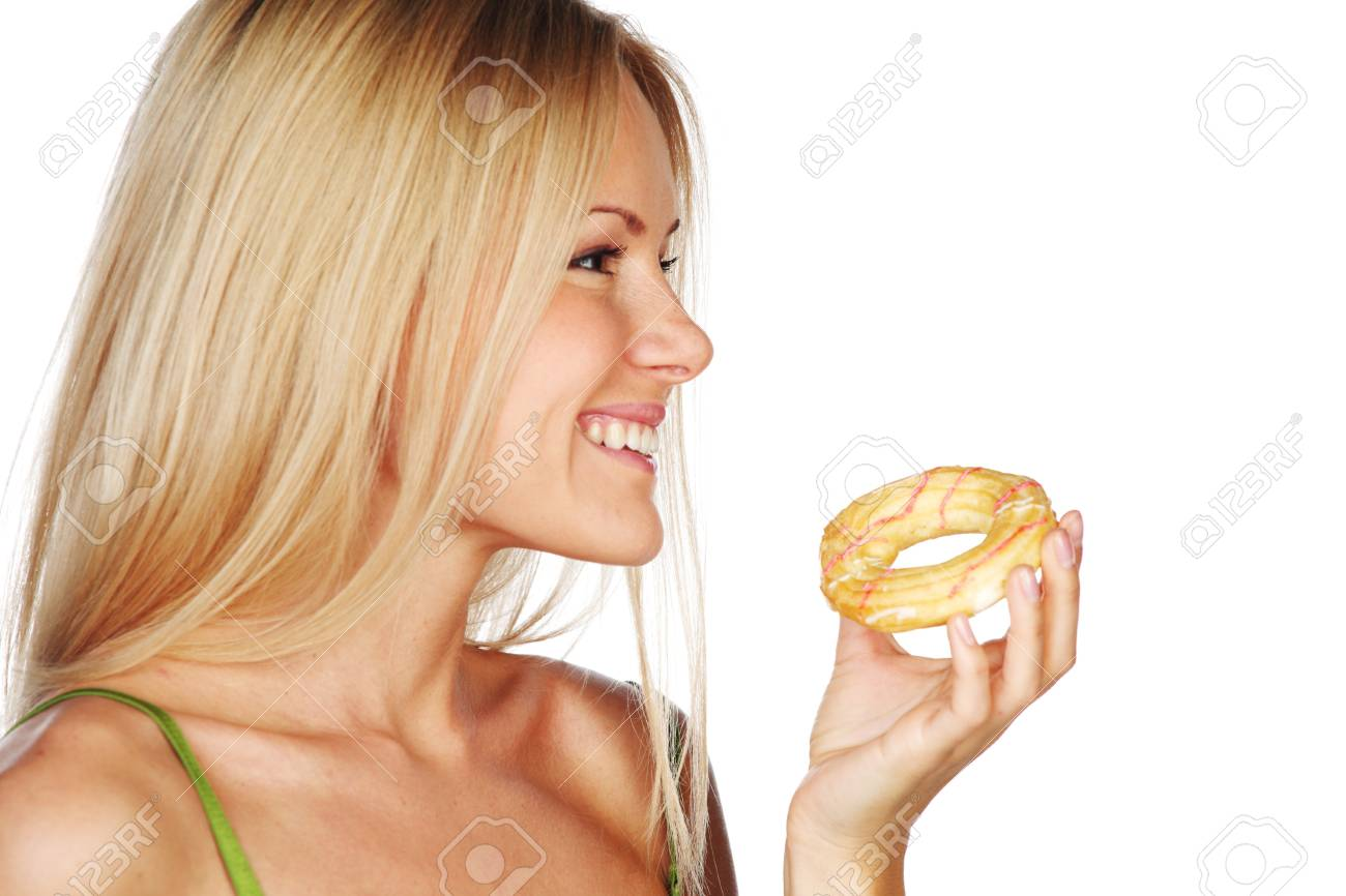 woman eating a cake on a white background Stock Photo - 10705620