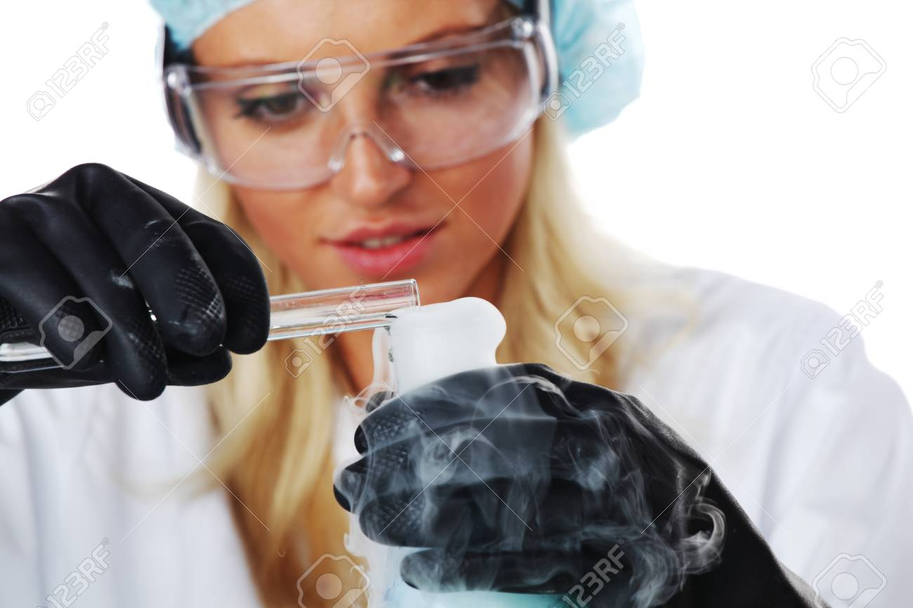 Woman  conducting a chemical experiment Stock Photo - 10813713