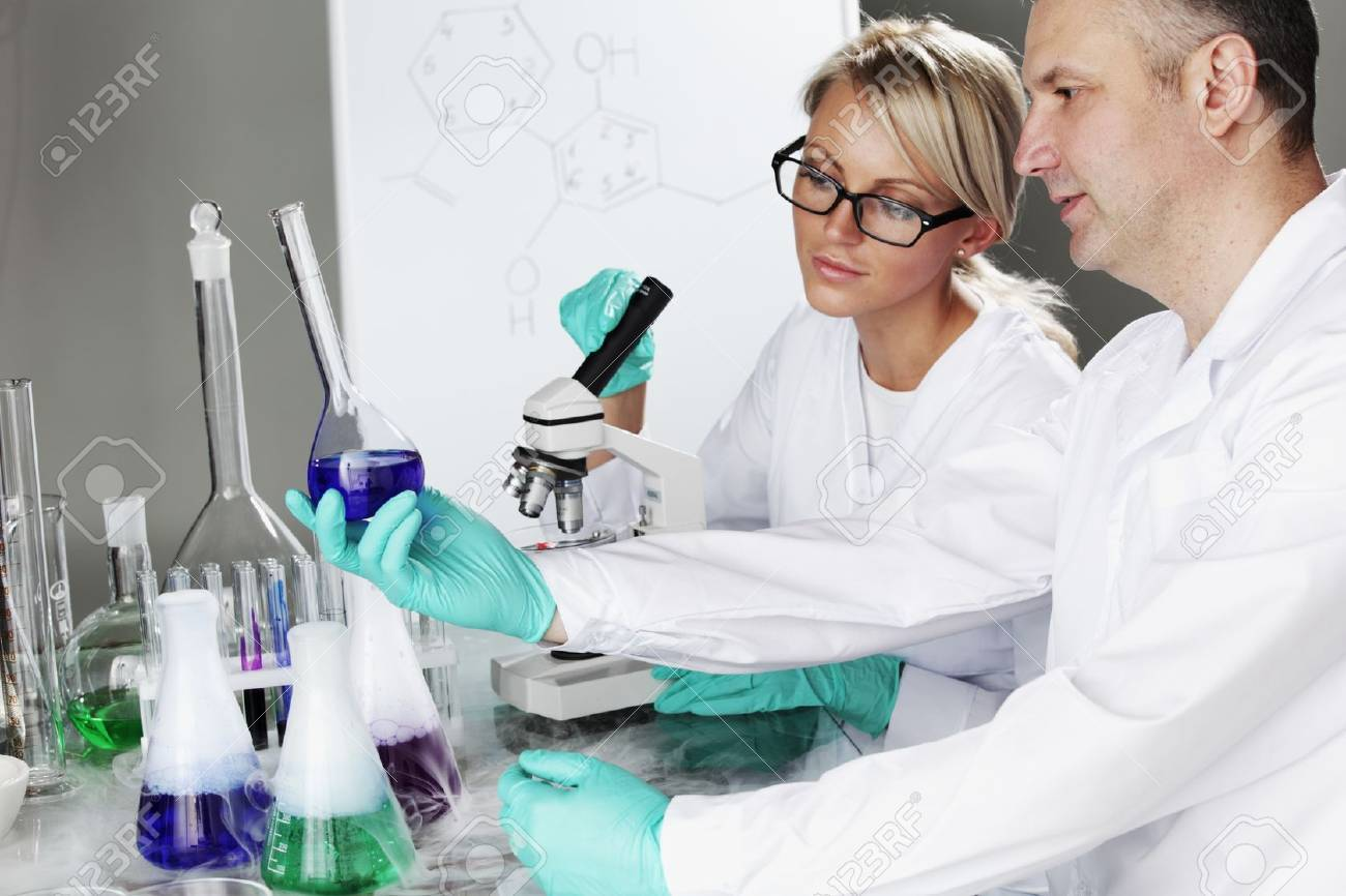 two scientist in chemical lab conducting experiments Stock Photo - 10813728