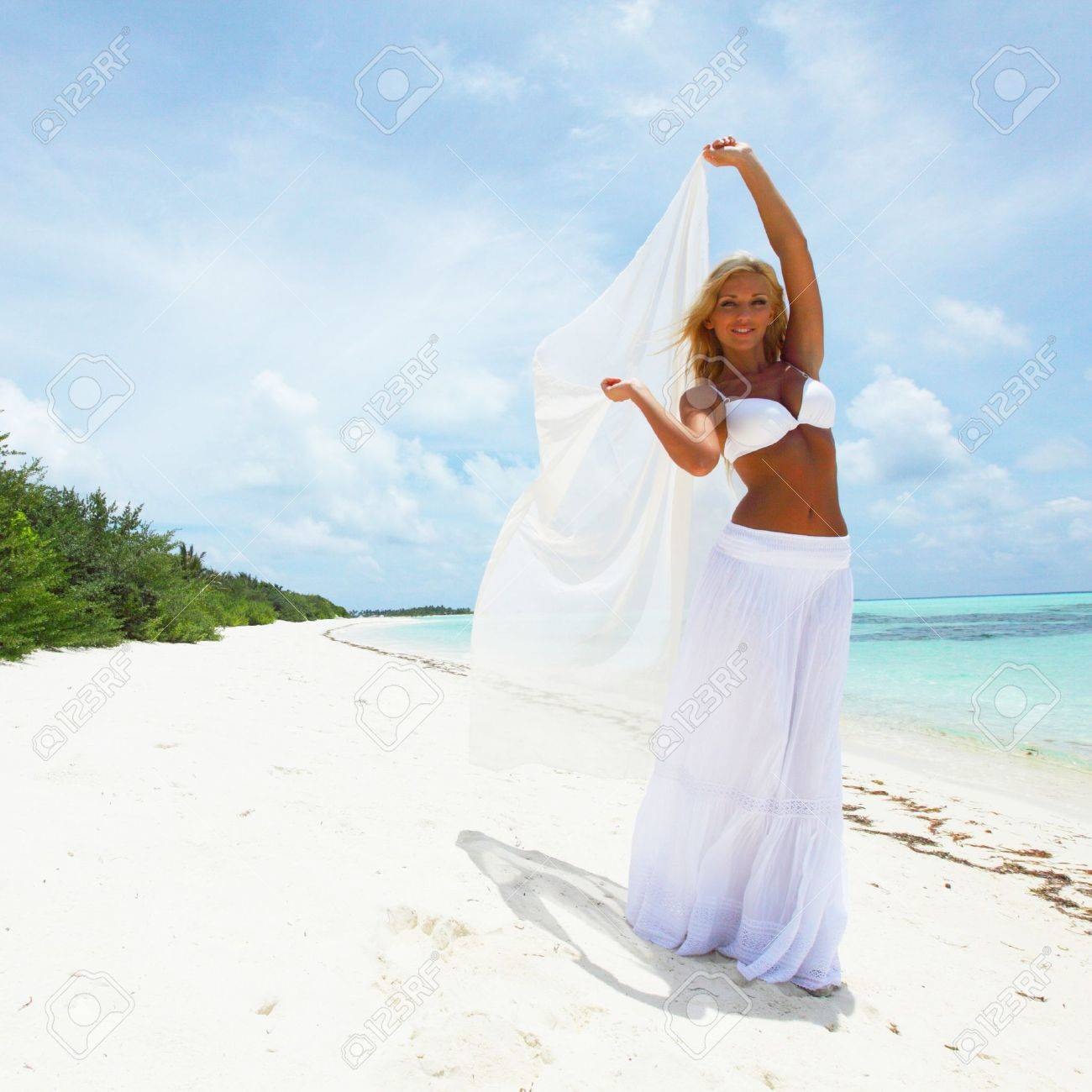 woman with a white cloth in his hands on the beach Stock Photo - 10895891