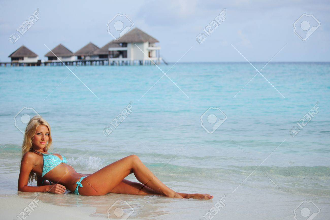 woman lying on the sand the ocean coast Stock Photo - 10895892