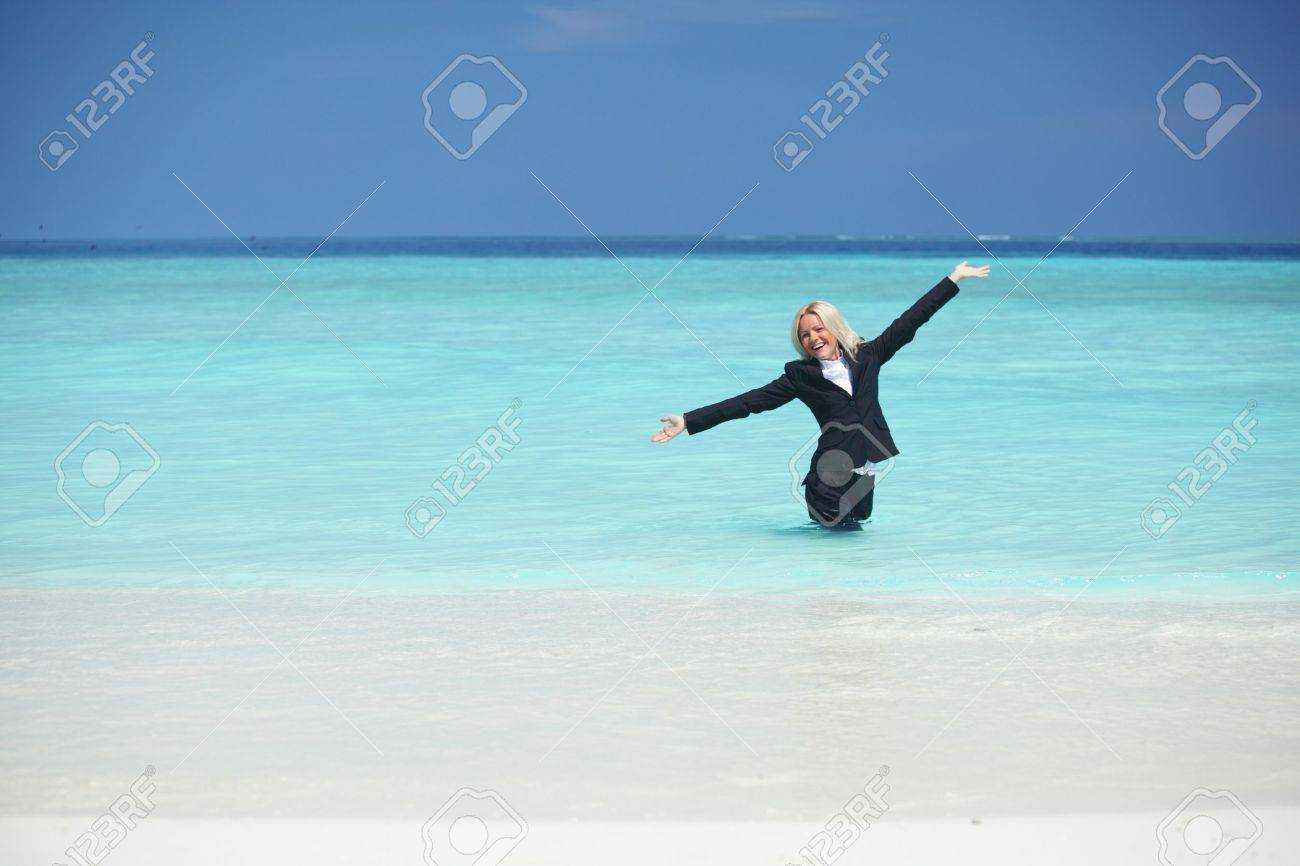 business woman stay in ocean waves Stock Photo - 10895897