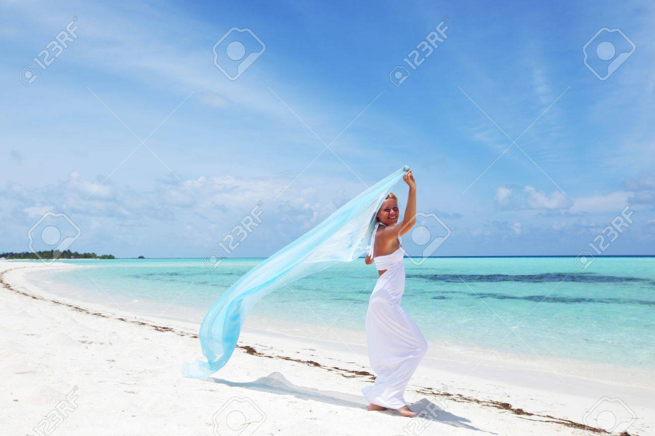 woman with a white fabric in his hands on the beach Stock Photo - 10896045