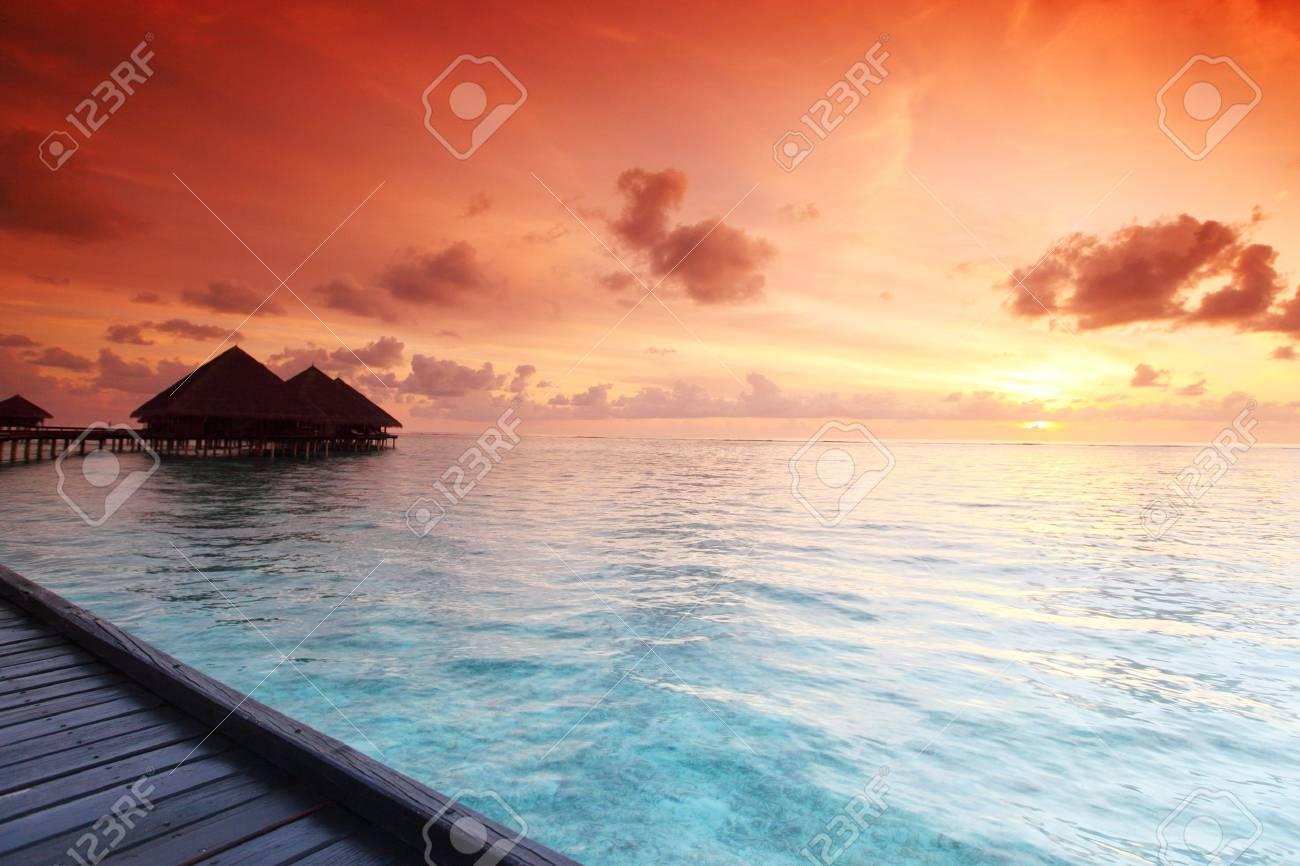 resort maldivian houses on sunrise Stock Photo - 10895820