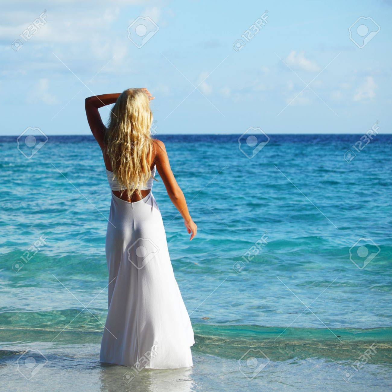 woman in a white dress on the ocean coast Stock Photo - 10896010