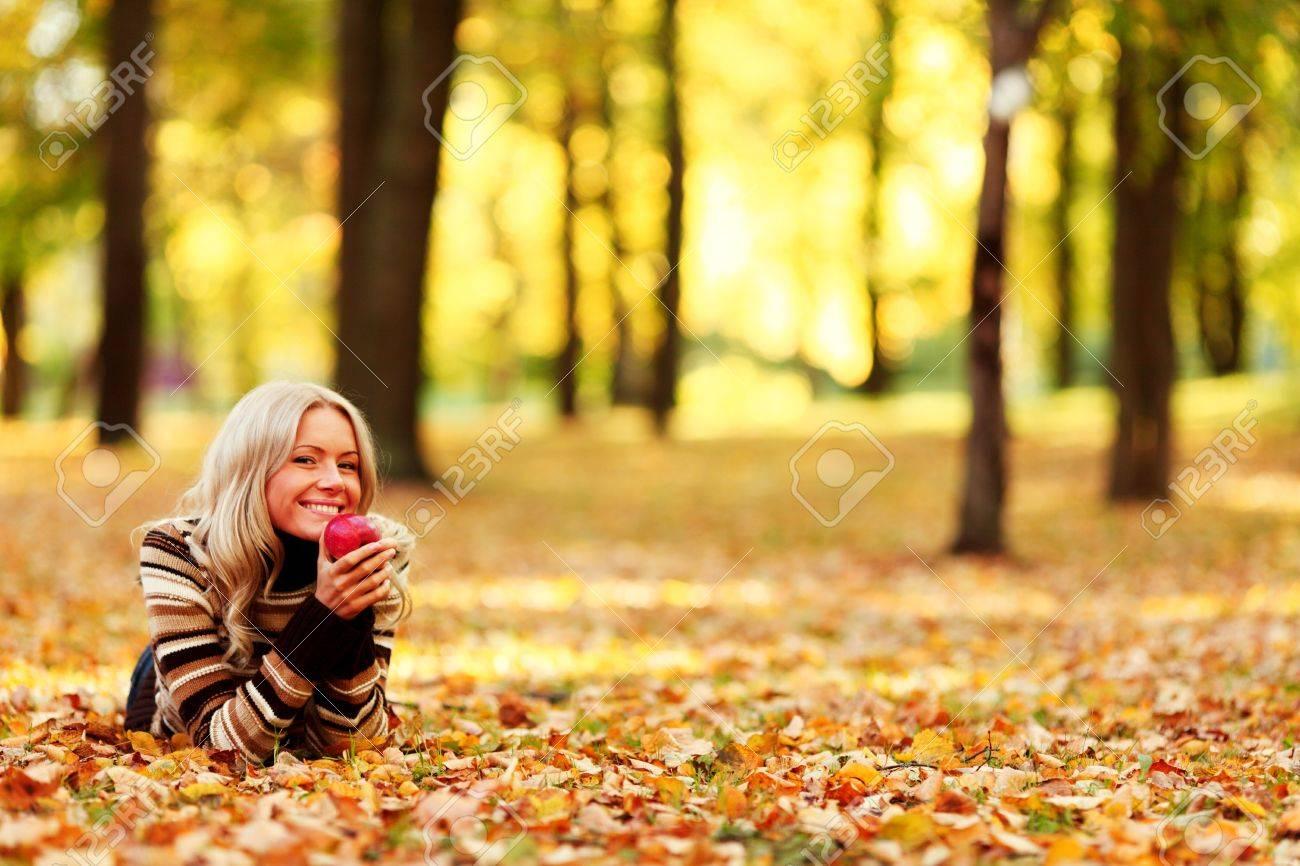 woman eat apple in autumn park Stock Photo - 10917467