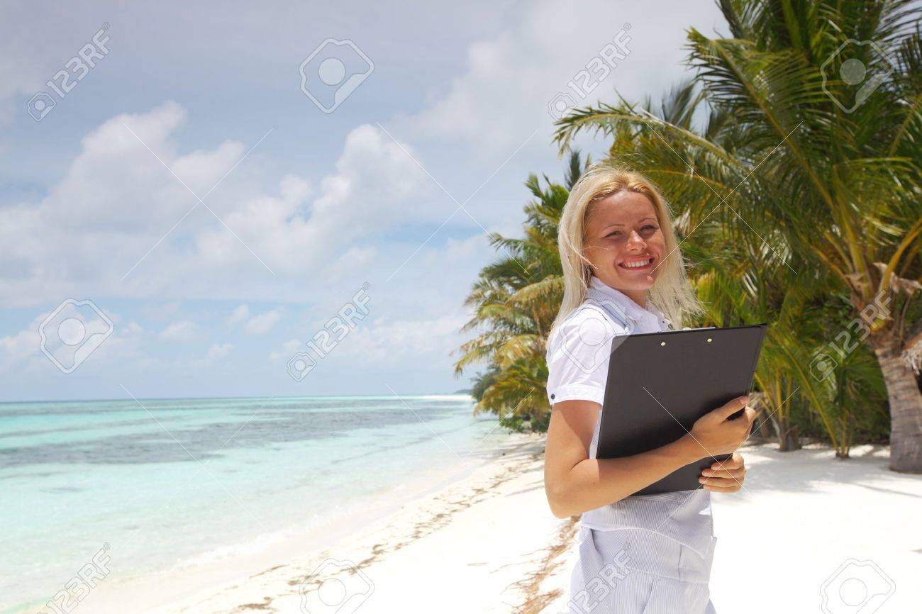 business woman on ocean coast on the background of a palm trees and sky and sea Stock Photo - 11031637