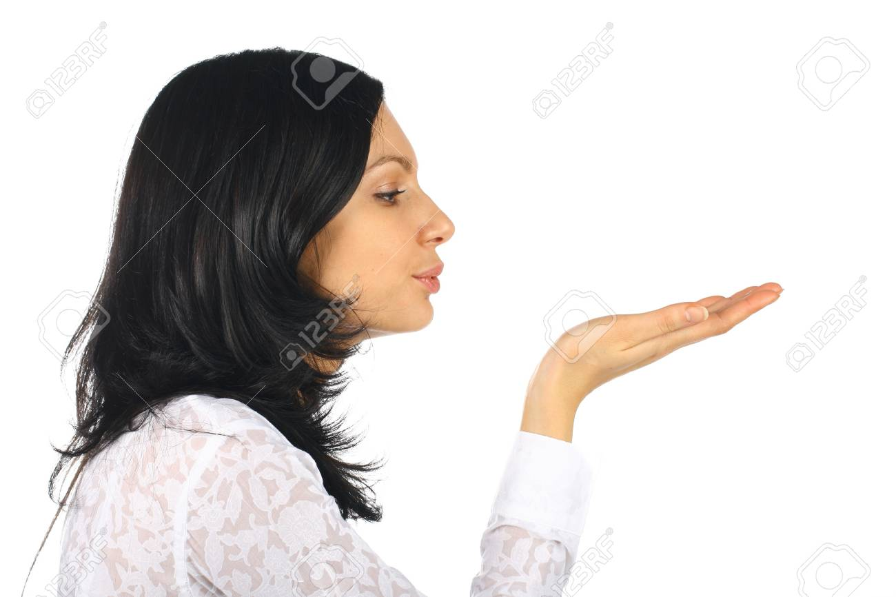 The girl the brunette blows on a hand in a direction Stock Photo - 11124115