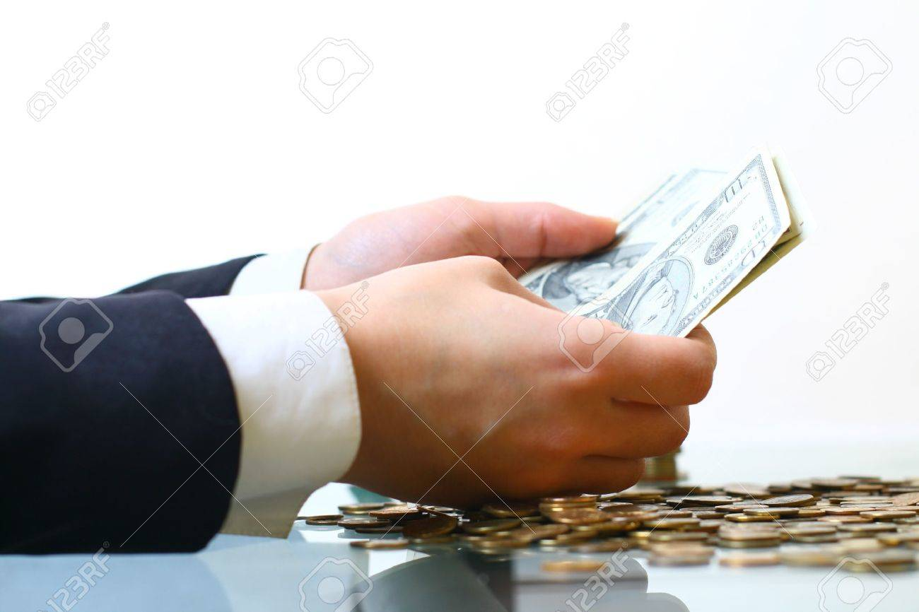 hands counting dollar money on white background Stock Photo - 11146071