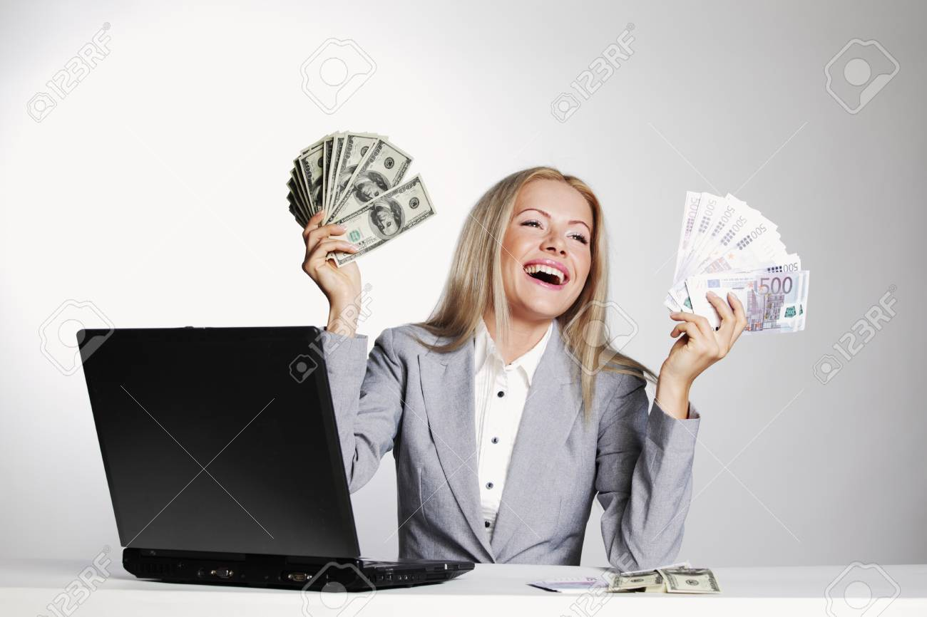 business woman working on laptop dollar in hands Stock Photo - 11367861