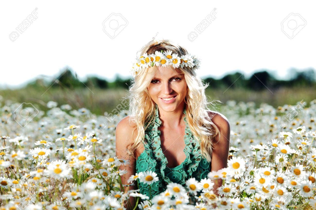 beautiful girl on the daisy flowers field - 11951368