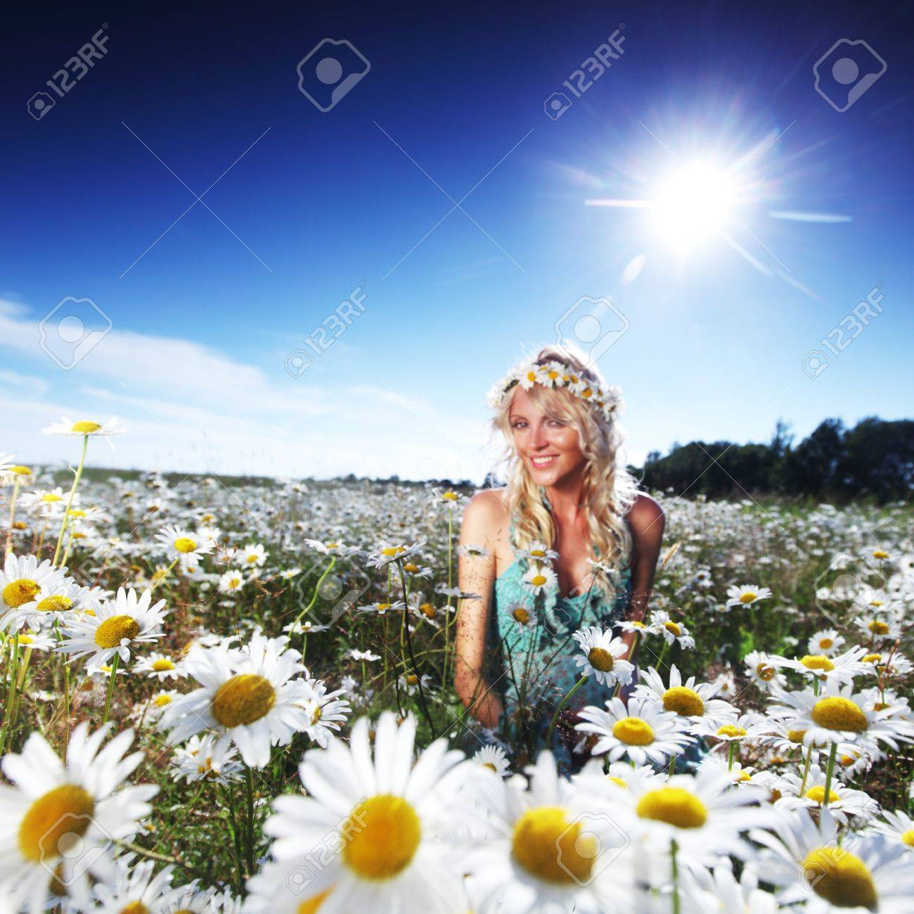 beautiful girl  in dress on the sunny daisy flowers field Stock Photo - 11950554