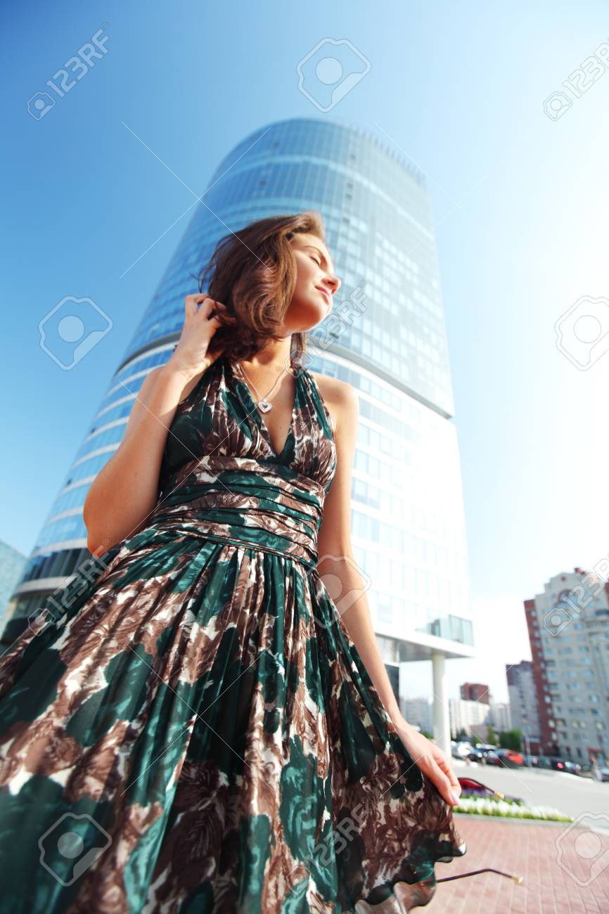 glamorous girl in the background of a skyscraper Stock Photo - 11951314
