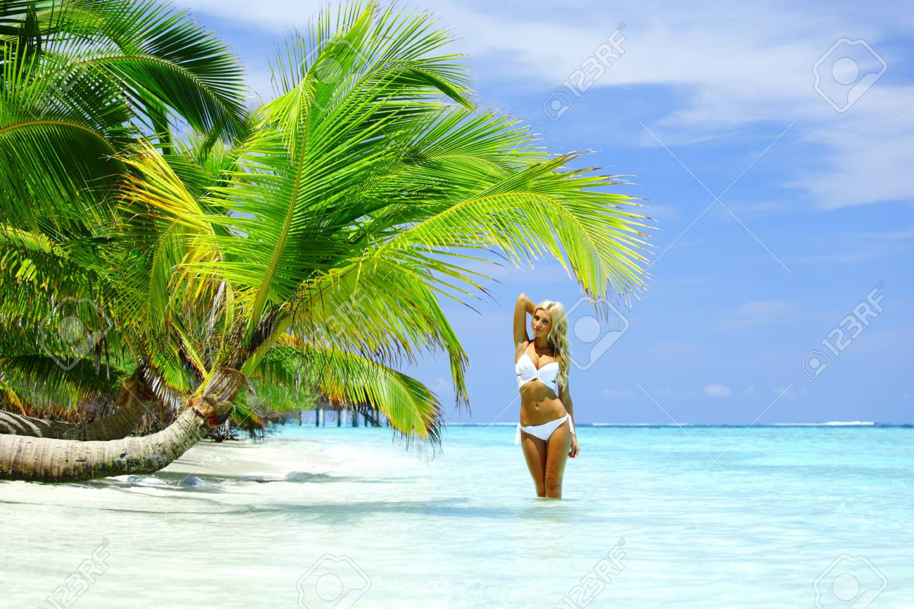 woman under palm sea on backgroud Stock Photo - 12079725