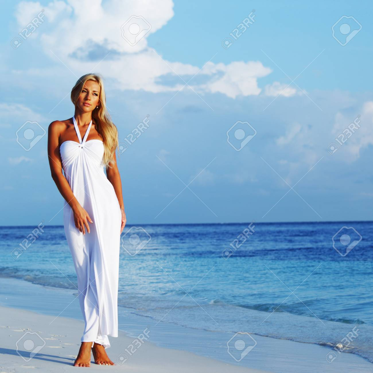 woman in a white dress on the ocean coast Stock Photo - 14130537
