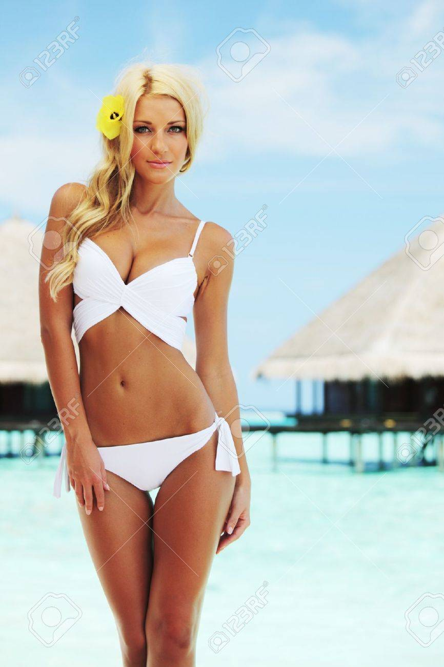 woman on tropical beach house back on the background Stock Photo - 15127242