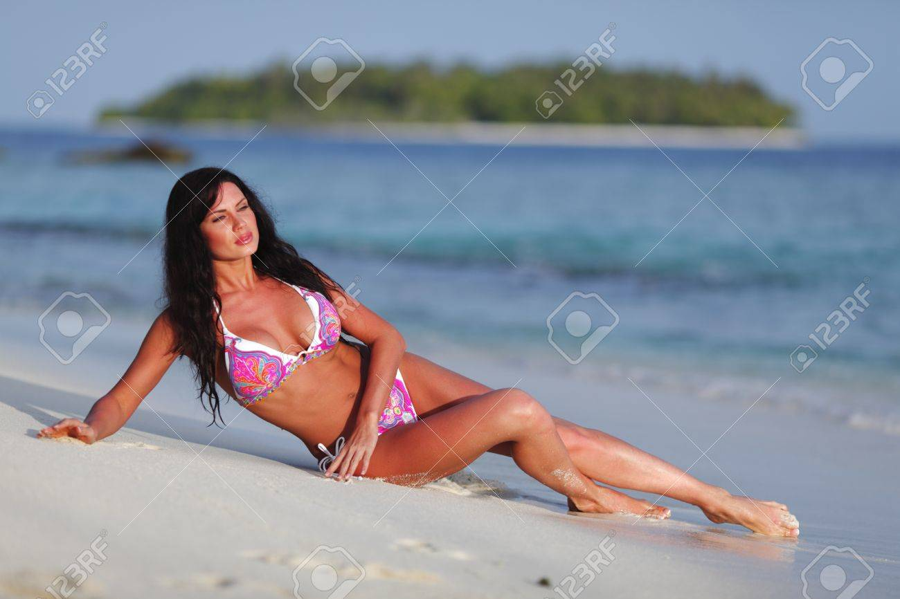 Beautiful woman in pink bikini on beach Stock Photo - 15982558