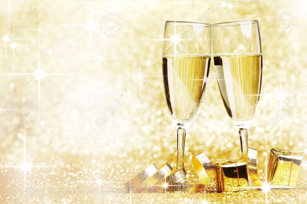 decorate champagne glasses. Two champagne glasses  gifts and decoration on golden background Stock Photo 24409103 Champagne Glasses Gifts And Decoration On Golden Background