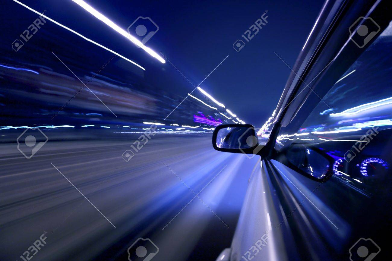 Side view on moving fast car at night Stock Photo - 25670554