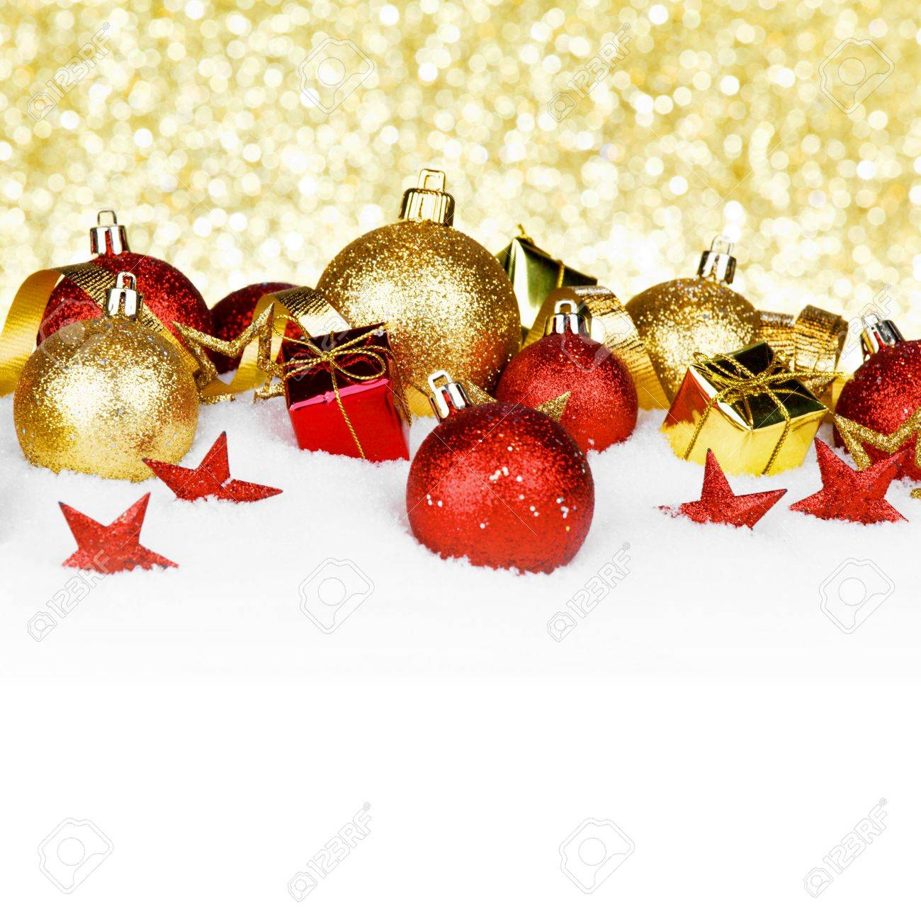 christmas card with colorful decorations in snow on gold background