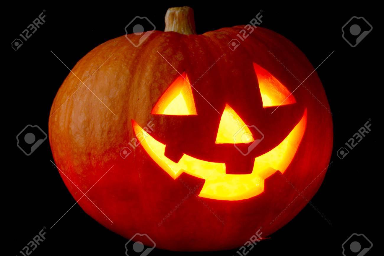funny halloween jack o' lantern pumpkin on black background stock