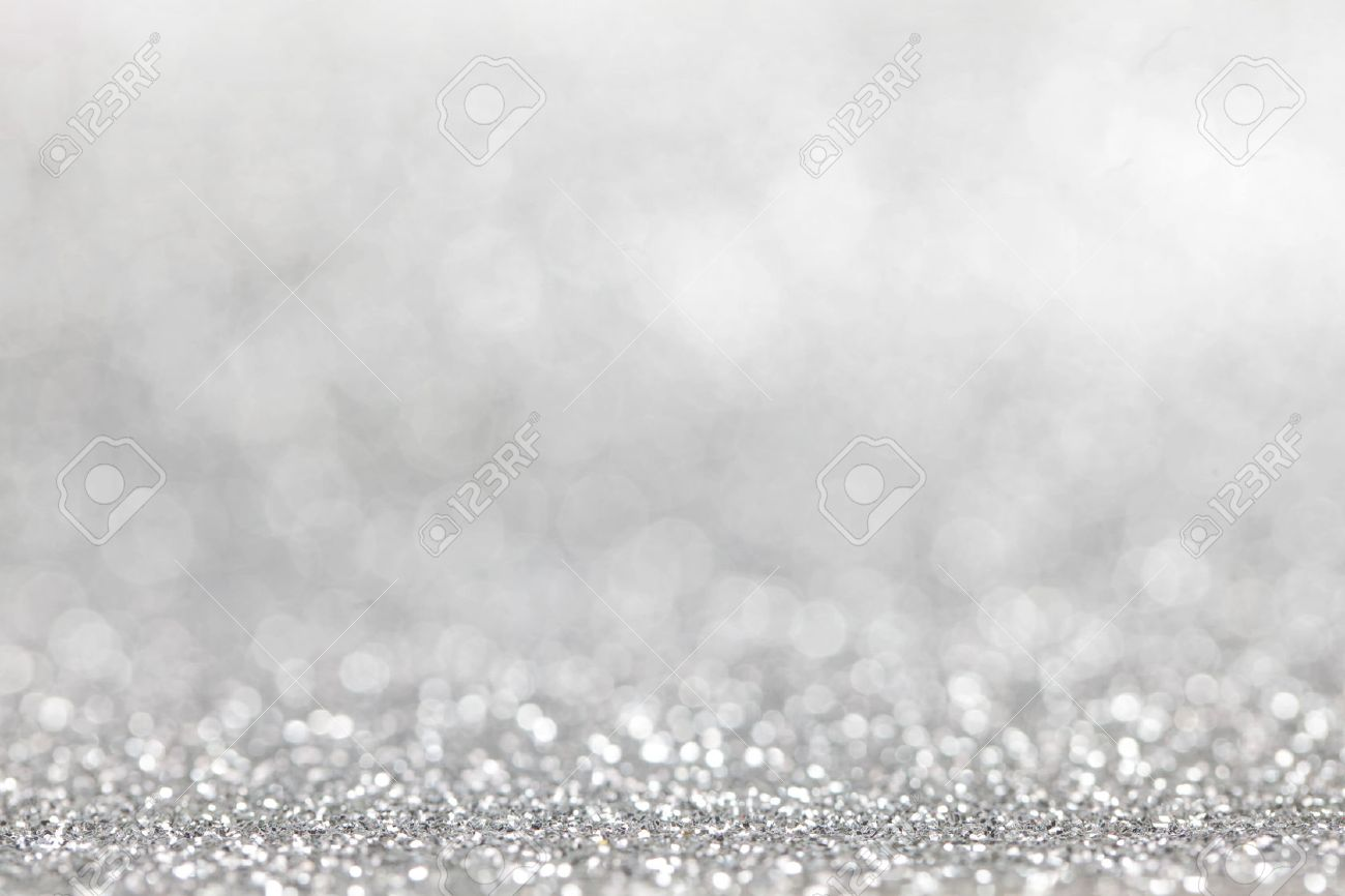 abstract silver glitter light bokeh holiday party background stock