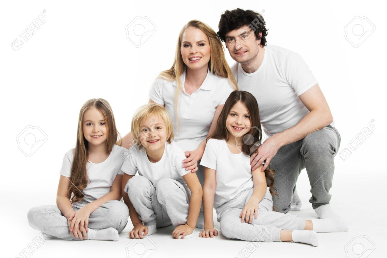 Stock photo studio portrait of family in white clothes with three children isolated on white background