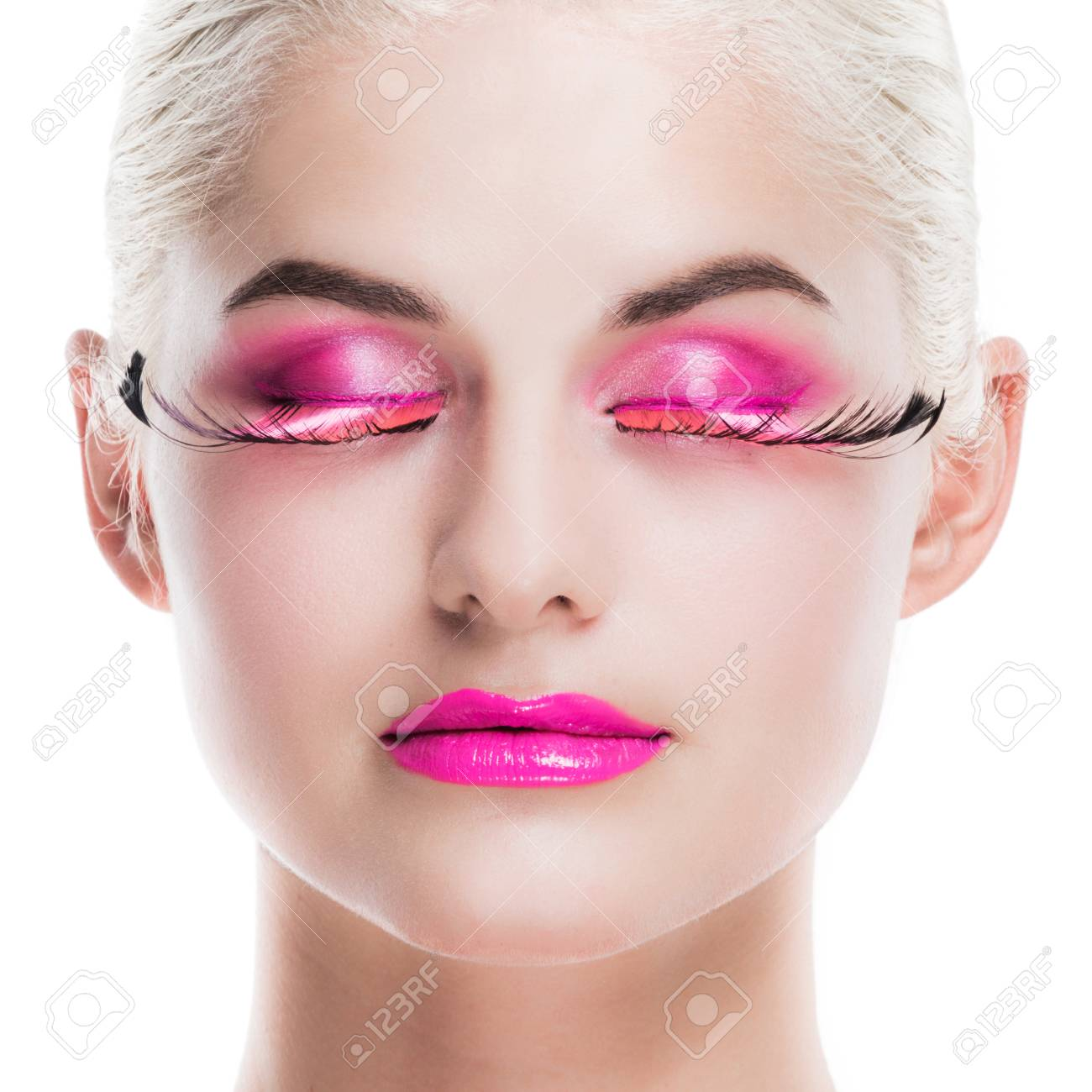 81512cb3112 Stock Photo - Woman with pink fancy makeup smoky eyeshadow with long feather  false eyelashes isolated on white background