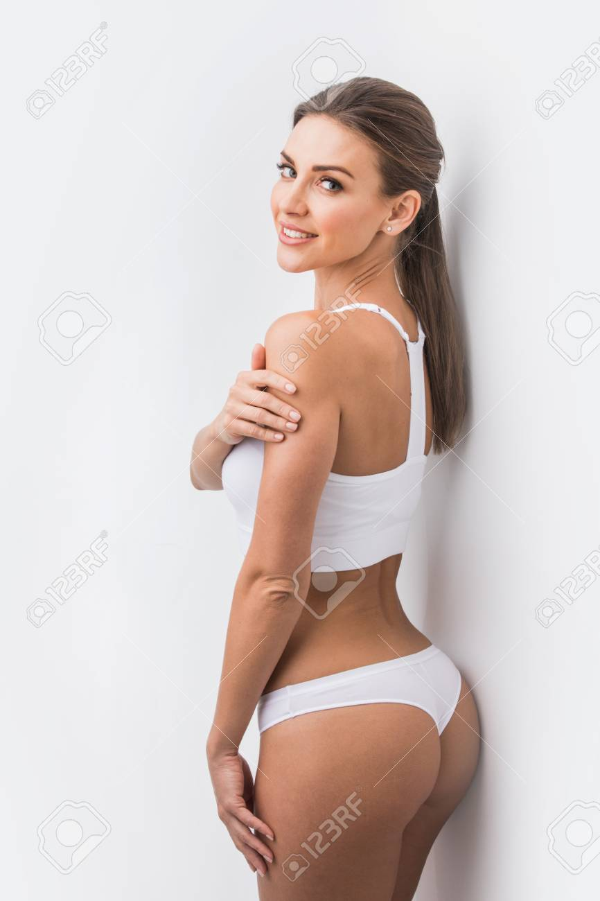 Stock Photo - Young beautiful woman in white cotton underwear on white  background bf0934762