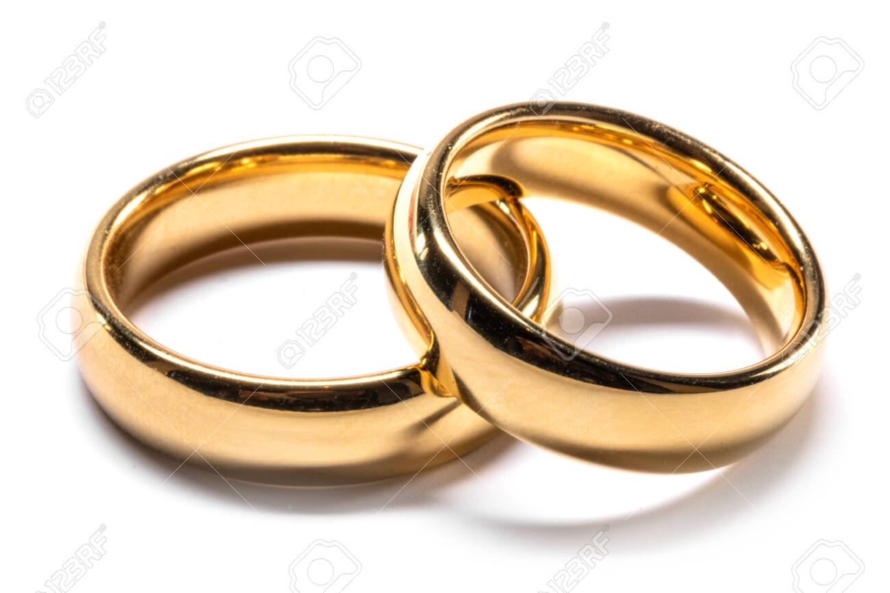 Couple of gold wedding rings isolated on white background - 138267985