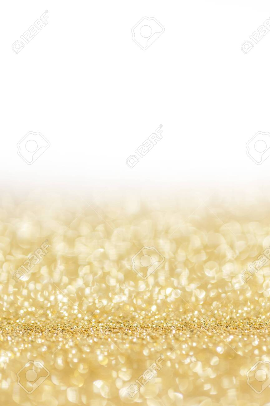 Shiny golden bokeh glitter lights abstract background, Christmas New Year party celebration concept - 157437744