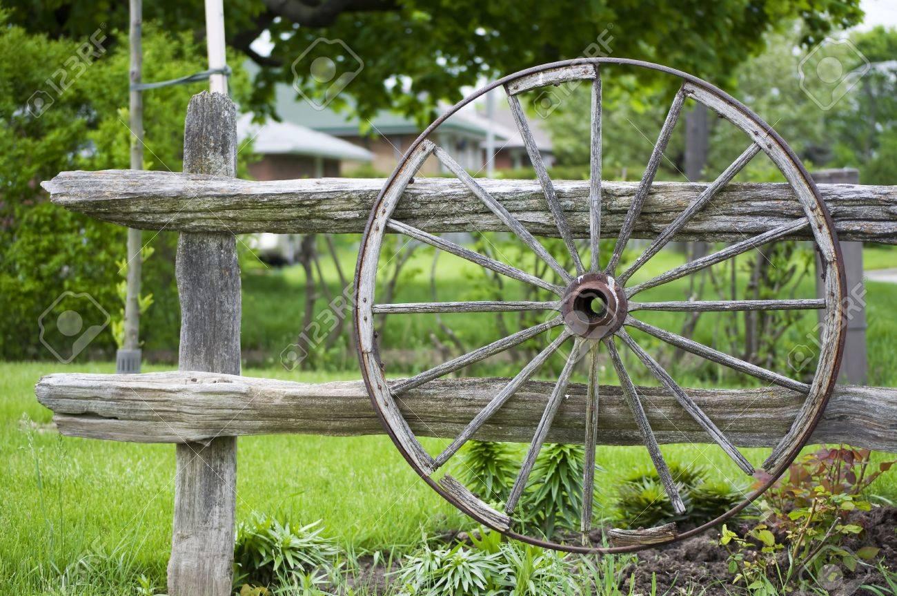 an old wagon wheel displayed as a garden decoration stock photo, Garden idea