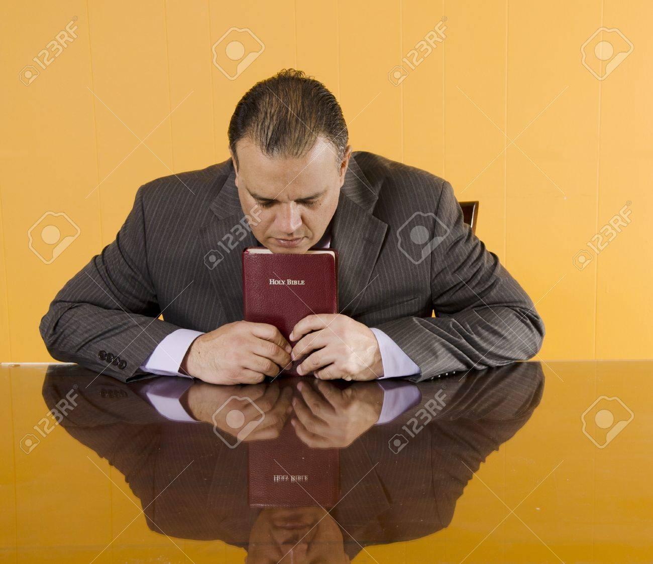 Daily devotional of a Hispanic business man Stock Photo - 13296904