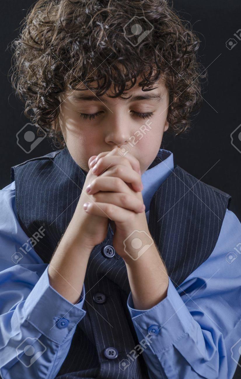 Young Latin boy praying and praising God Stock Photo - 14959106