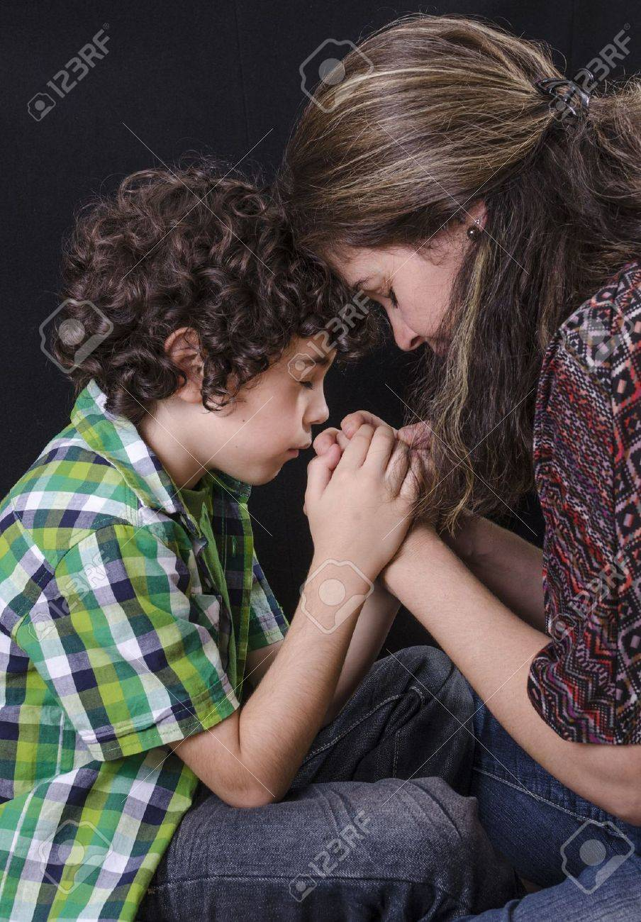 Mother and son praying and praising God Stock Photo - 14959112