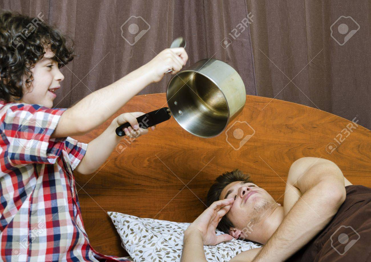 Young boy awakes his brother by making noises Stock Photo - 16409365