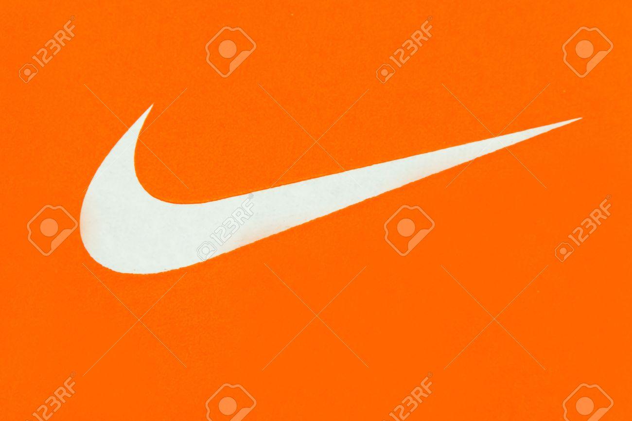bde76ddc6ce2 White Nike Logo On Orange Background Nike
