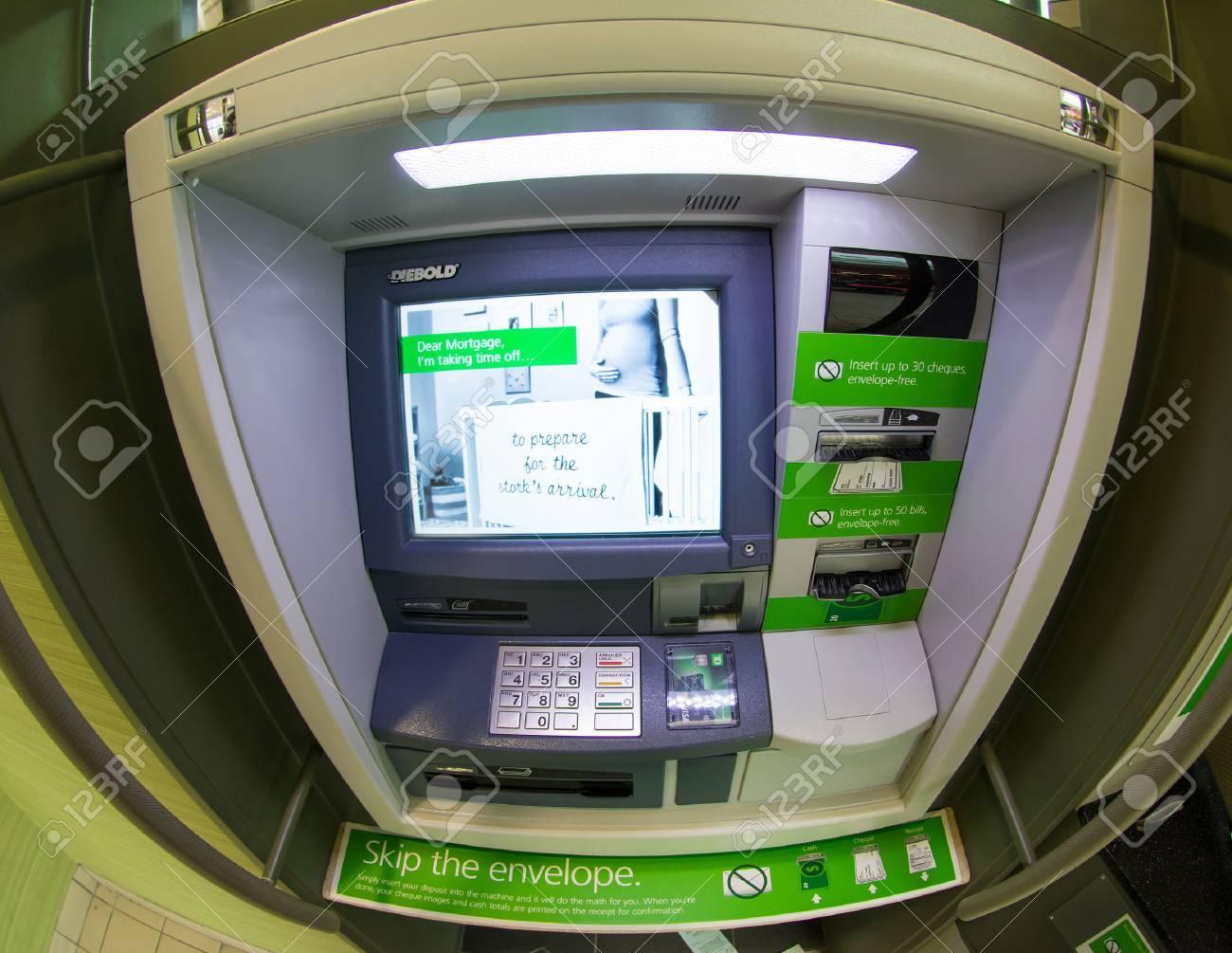 TORONTO,CANADA-APRIL 4,2015: TD bank ATM, discard the envelope