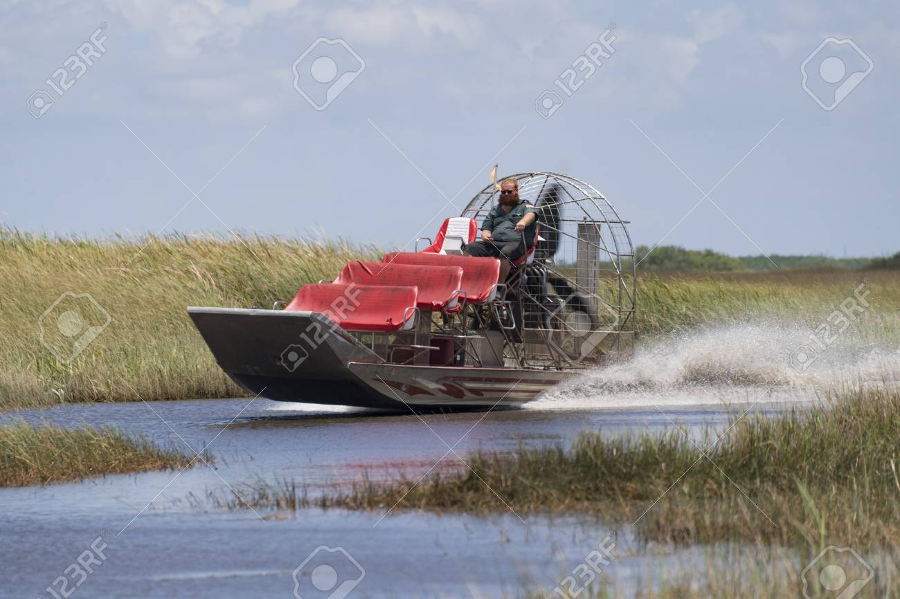 Airboat moving fast in the shallow waters of the Everglades