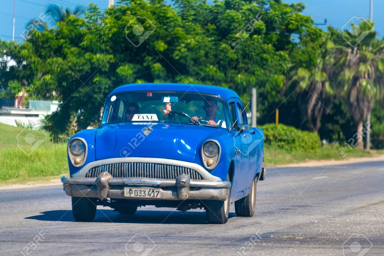 Vintage Cuban blue car driving in the Varadero highway  The