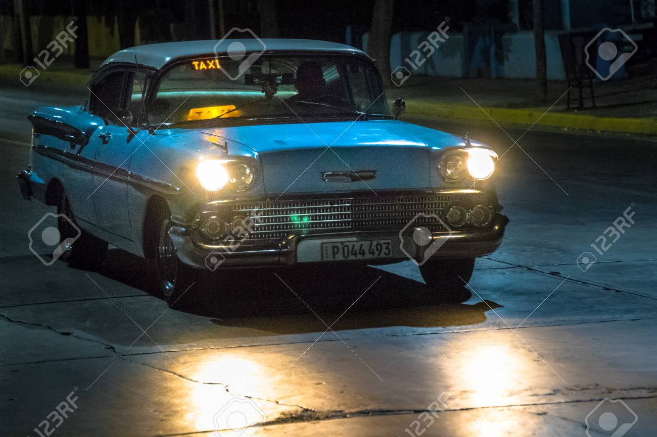 Chevrolet, Old obsolete American cars in action during nighttime